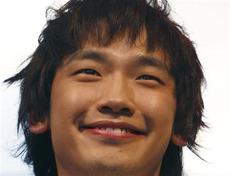 South Korean pop star Rain smiles during an appearance in Bangkok on May 26, 2007. REUTERS/Adrees Latif