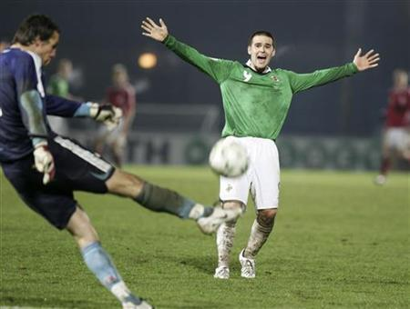 Northern Ireland's David Healy (R) celebrates at the end of the game after beating Denmark 2-1 in their Euro 2008 Group F qualifying soccer match in Belfast November 17, 2007. Healy has joined Premier League club Sunderland from Fulham for an undisclosed fee, the north-east club said on Thursday. REUTERS/Michael Cooper