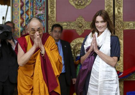 Tibetan spiritual leader Dalai Lama (L) and France's first lady Carla Bruni-Sarkozy attend the inauguration of the Buddhist Lerab Ling temple in Roqueredonde, southern France, August 22, 2008. REUTERS/Philippe Laurenson