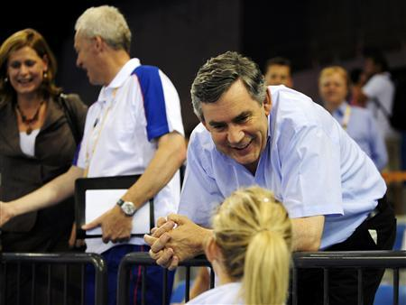 British Prime Minister Gordon Brown (top) speaks with competitor Katy Livingstion of Britain (bottom) during the fencing event of the women's modern pentathlon competition at the Beijing 2008 Olympic Games August 22, 2008. On L : Gordon Brown's wife Sarah. REUTERS/Desmond Boylan