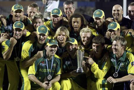 Australian players hold the ICC champions trophy during the award ceremony after Australia beat West Indies in the final match in Mumbai November 5, 2006. REUTERS/Adnan Abidi