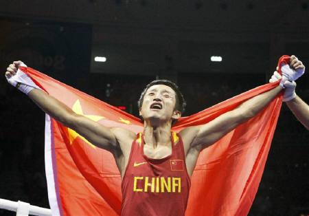 Zou Shiming of China celebrates after defeating Purevdorj Serdamba of Mongolia in their light flyweight (48kg) final boxing match at the Beijing 2008 Olympic Games, August 24, 2008. REUTERS/Lee Jae-Won