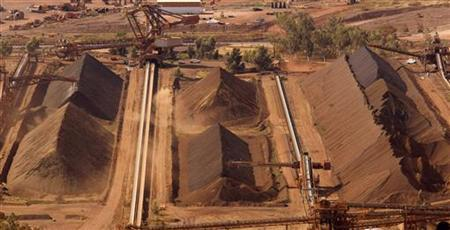 A bucket wheel reclaimer and stacker operate at a stockpile area at a Rio Tinto iron ore mine at Tom Price, about 1,300 km (800 miles) north of Perth May 28, 2008. REUTERS/Tim Wimborne