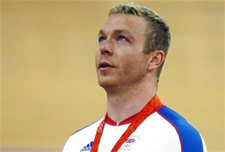 Chris Hoy of Britain cries as he stands on the podium after winning the gold medal in the men's sprint track cycling race at the Beijing 2008 Olympic Games August 19, 2008. REUTERS/Phil Noble