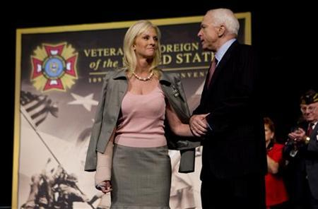 U.S. Republican presidential candidate Senator John McCain (R-AZ) (R) is introduced on stage with wife Cindy at the 109th Veterans of Foreign Wars convention in Orlando, Florida, August 18, 2008. Cindy McCain is traveling to Georgia this week to assess the humanitarian situation there after its military conflict with Russia, the Arizona senator said on Monday. REUTERS/Scott Audette