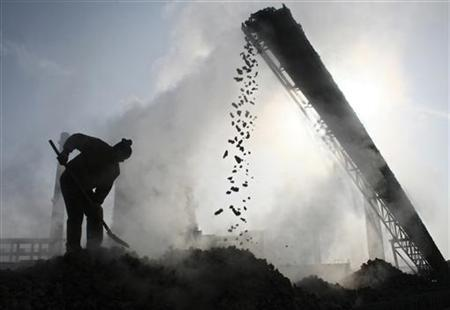 A labourer works at a coal factory in Baicheng county, northwest China's Xinjiang Uygur Autonomous Region, January 7, 2007. REUTERS/China Daily