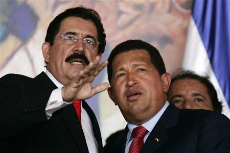 Honduran President Manuel Zelaya (L) speaks to his Venezuelan counterpart Hugo Chavez during his arrival at the presidential house for the signing of Honduras' accession to the Bolivarian Alternative for the Americas (ALBA) in Tegucigalpa August 25, 2008. REUTERS/Edgard Garrido