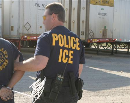 An Immigration and Customs Enforcement agent in an undated photo courtesy of the agency. Immigration agents have arrested 595 people at a Mississippi factory in what was the largest workplace enforcement raid in the United States to date, an immigration official said on Tuesday. REUTERS/ICE/Handout