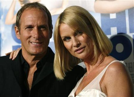 Nicollette Sheridan and Michael Bolton pose at the premiere of ''Over Her Dead Body'' at the ArcLight theatre in Hollywood, January 29, 2008. REUTERS/Mario Anzuoni
