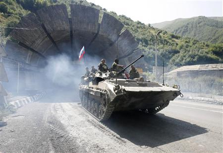 A Russian armoured vehicle leaves the tunnel in the territory of South Ossetia as it heads towards the Russian border, August 26, 2008. REUTERS/Sergei Karpukhin