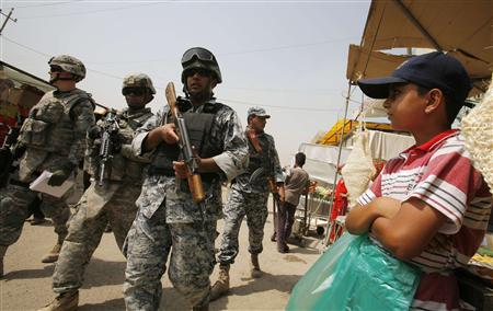U.S. soldiers from the First Infantry Division, First Brigade Combat Team and Iraqi policemen patrol at Baghdad's Dora market August 27, 2008. REUTERS/Andrea Comas