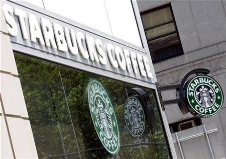 Starbucks signs are seen outside one of its stores in New York July 3, 2008. REUTERS/Chip East