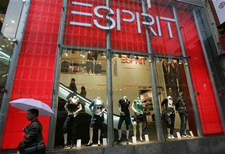 A man walks past an Esprit outlet in Hong Kong, January 30, 2008. REUTERS/Bobby Yip