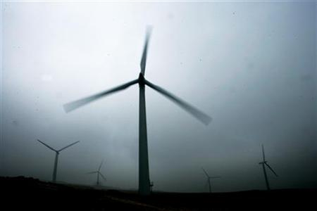 Wind turbines are seen at a wind farm near Kendal in northern England September 23, 2005. REUTERS/Dylan Martinez