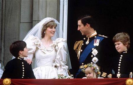 Prince Charles and Princess Diana stand on the balcony of Buckingham Palace in London, following their wedding at St. Pauls Cathedral, June 29, 1981. REUTERS/Stringer