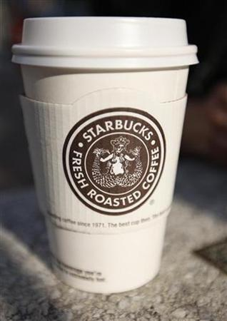 A Starbucks coffee cup sits on a table in New York July 3, 2008. REUTERS/Chip East