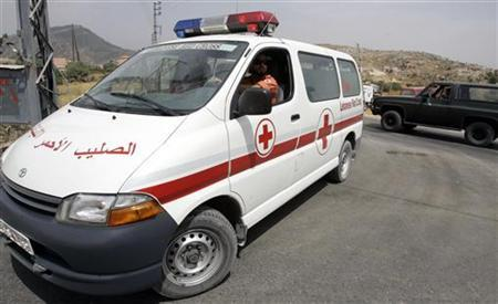 A Lebanese Red Cross ambulance and an army vehicle is seen near the site of an army helicopter crash landing in south Lebanon, August 28, 2008. REUTERS/Ali Hashisho