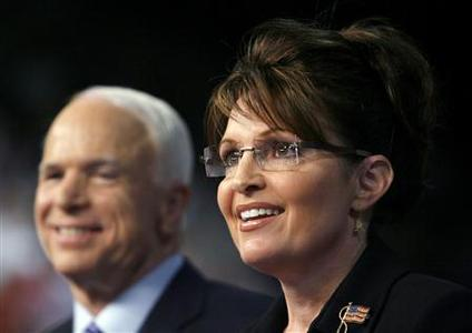 Republican presidential candidate Senator John McCain looks on as his vice presidential running mate Alaska Governor Sarah Palin speaks at a campaign event in Dayton, Ohio August 28, 2008. REUTERS/John Gress