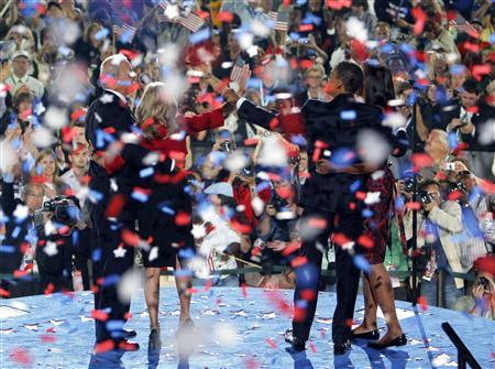 Democratic presidential nominee Senator Barack Obama (D-IL) (R) and vice presidential nominee Sen. Joe Biden (D-DE) stand with their wives Michell Obama and Jill Biden, as confetti falls following Obama's acceptance speech at the 2008 Democratic National Convention in Denver, Colorado August 28, 2008. REUTERS/Brian Snyder