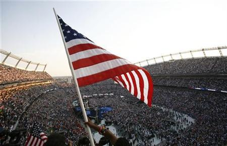 An attendee waves a U.S. flag at top of stadium at the 2008 Democratic National Convention in Denver, Colorado August 28, 2008. REUTERS/Shannon Stapleton