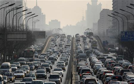 Cars are driven in Beijing's city center in this January, 15, 2008 file photo. REUTERS/Reinhard Krause/Files