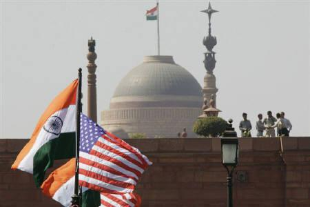 Indian and U.S. national flags flutter in front of the Presidential Palace in New Delhi in this February 28, 2006 file photo. China's top newspaper called a nuclear agreement between India and the United States a ''major blow'' to non-proliferation, raising pressure as the deal faces opposition in an international atomic cartel. REUTERS/B Mathur