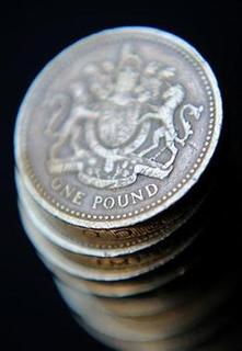 A pile of one pound coins is seen in central London June 17, 2008. The Bank of England said on Sunday it had no plans to extend an innovative six-month scheme designed to ease strains in the mortgage market. REUTERS/Toby Melville
