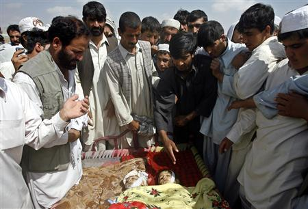 Afghans look at the bodies of two children who they say were killed by U.S-led troops in Kabul early September 1, 2008. REUTERS/Omar Sobhani