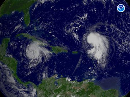 Hurricane Gustav (L) and Tropical Storm Hanna in a satellite image taken August 29, 2008. REUTERS/NOAA/Handout