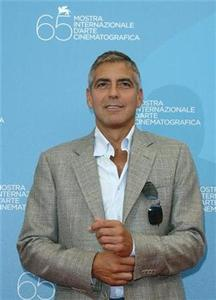 Actor George Clooney poses during a photocall in Venice, August 27, 2008. REUTERS/Denis Balibouse