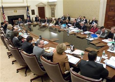 Federal Reserve Chairman Ben Bernanke (fourth from top at left) with the Board of Governors during a Federal Open Market Committee meeting in a file photo. REUTERS/Federal Reserve/Handout