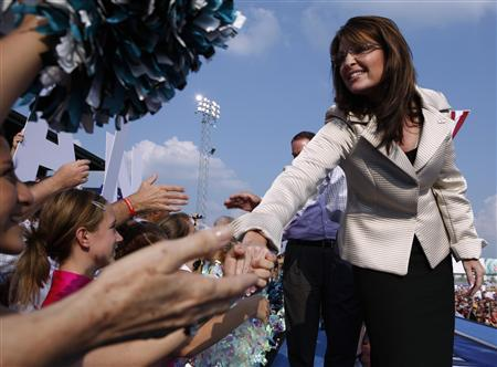 Republican vice-presidential candidate Alaska Governor Sarah Palin shakes hands as she campaigns in O'Fallon, Missouri August 31, 2008. REUTERS/John Gress