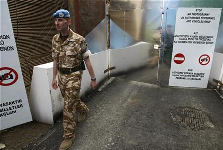 A U.N. soldier walks towards Ledra Street after its opening in Nicosia April 3, 2008. REUTERS/Yiorgos Karahalis