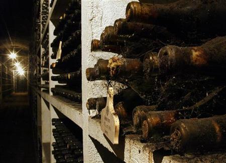 Vintage wine bottles piled up in the cellar of the Ramos Pinto Museum in Porto city, February 15, 2004. REUTERS/Jose Manuel Ribeiro