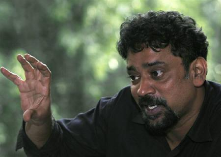 Bollywood director Santosh Sivan gestures as he speaks during an interview with Reuters in New Delhi August 30, 2008. REUTERS/Adnan Abidi