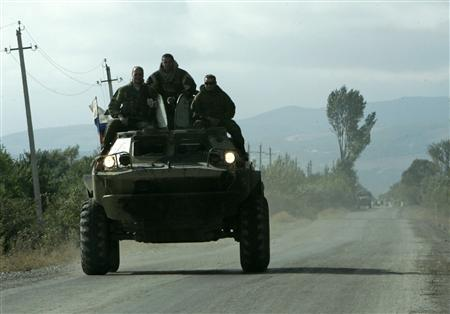 Russian soldiers drive an armoured vehicle in the village of Tirdznisi near Gori some 50 miles west of Tbilisi September 2, 2008. REUTERS/David Mdzinarishvili