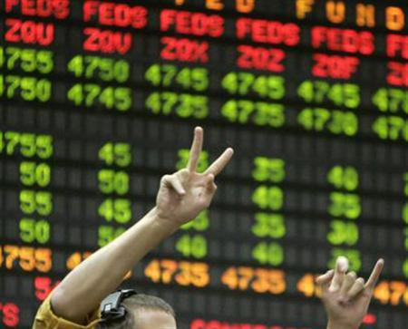 A trader signals an order in a file photo. REUTERS/File