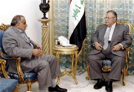 Iraqi President Jalal Talabani (R) meets Iraqi Vice President Adel Abdul Mahdi at his office in Baghdad July 23, 2008. REUTERS/Iraqi government office/Handout