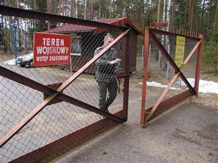 A guard shuts the gate to the airport in Szymany in northeastern Poland in this file 2005 picture. Human Rights Watch identified the airport as a potential site of alleged CIA prisons used to interrogate al Qaeda captives. Poland strongly denied it was hosting such facilities. REUTERS/FORUM/Tomasz Marek