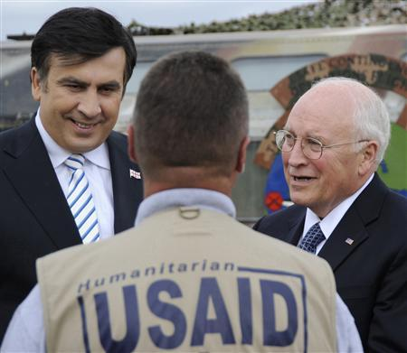 U.S. Vice President Dick Cheney (R) and Georgia's President Mikheil Saakashvili (L) listen to explanations as they check the delivery of humanitarian aid at Tbilisi airport, September 4, 2008. REUTERS/Irakli Gedenidze/Pool