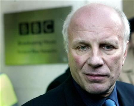 Then BBC Director-General Greg Dyke leaves BBC Broadcasting House in London after his resignation, January 29, 2004. REUTERS/Hugo Philpott