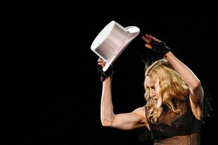 Madonna performs during the opening night of her ''Sticky & Sweet'' tour at the Millennium Stadium in Cardiff August 23, 2008.REUTERS/Luke MacGregor