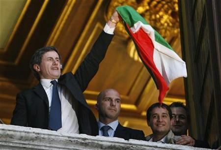 Then People of Freedom coalition mayoral candidate for Rome, Gianni Alemanno waves an Italian flag from a city hall window in Rome April 28, 2008. REUTERS/Dario Pignatelli