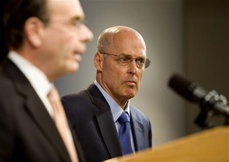 Secretary of the Treasury Henry Paulson (R) listens as Jim Lockhart, Director of the the new independent regulator, the Federal Finanace Agency (FHFA), speaks during a news conference, announcing that the government is taking control of mortgage finance companies Fannie Mae and Freddie Mac, at the Office of Management Supervision in Washington, DC, September 7, 2008. REUTERS/Joshua Roberts