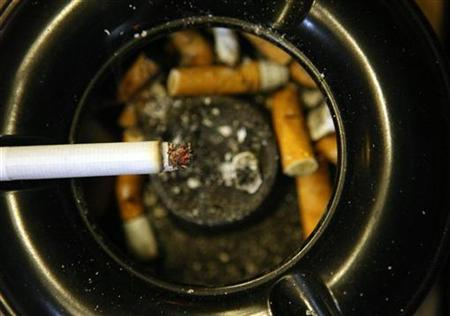 A cigarette lies in ashtray in front of a pub in Bensheim early July 30, 2008. REUTERS/Alex Grimm