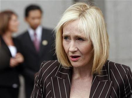 J.K. Rowling, author of the Harry Potter book series, makes a statement before leaving the U.S. District Court in New York April 14, 2008. A U.S. judge on Monday ruled in favor of Warner Brothers Entertainment Inc and author Rowling over the publication of an unofficial encyclopedic companion to the popular Harry Potter book series. REUTERS/Joshua Lott