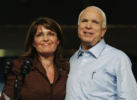 Republican presidential nominee Senator John McCain (R-AZ) and Republican vice-presidential nominee Alaska Governor Sarah Palin (L) stand together onstage at a campaign rally in Albuquerque, New Mexico September 6, 2008. REUTERS/Brian Snyder