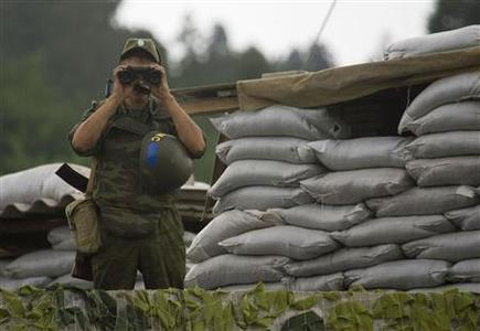 A Russian peacekeeper is seen at the checkpoint in the village of Khobi, September 8, 2008. REUTERS/Vasily Fedosenko