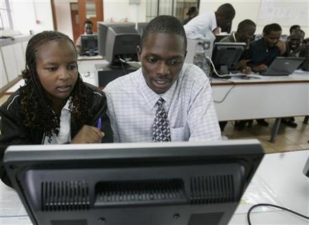 Nairobi University students study with computers in Nairobi March 27, 2008. REUTERS/Antony Njuguna
