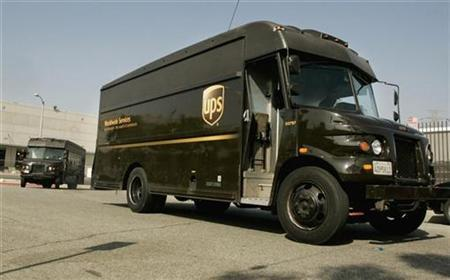 United Parcel Service (UPS) vehicles depart from a UPS facility in Los Angeles, July 22, 2008. REUTERS/Fred Prouser